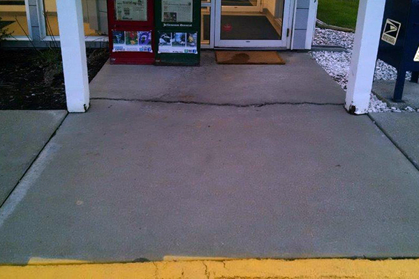 Before picture of cracked concrete sidewalk