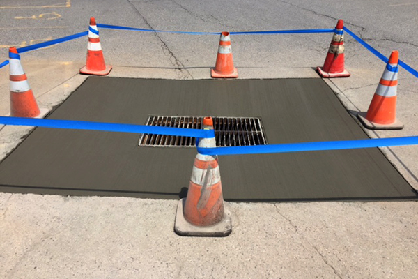 After photo of repaired drainage grate